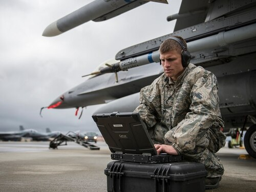 Staff Sgt. Zackery Coder, a crew chief, checks computer data to make sure the F-16 Fighting Falcon was ready for the next sortie during a Red Flag exercise in Alaska. The Air Force is looking to grow its ranks of cyber airmen in order to better protect the service's networks. (Senior Airman Peter Reft/Air Force)