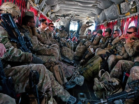 Soldiers with the 82nd Airborne Division sit aboard a CH-47 Chinook helicopter en route to Camp Dahlke, Afghanistan, in 2014. (Staff Sgt. Whitney Houston/Army)