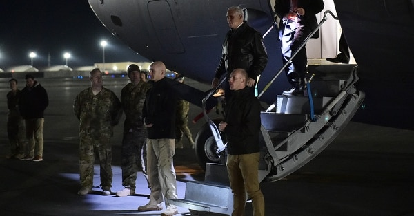 Vice President Mike Pence steps off a plane upon arrival for a surprise visit at Bagram Air Field in Afghanistan on Dec. 21, 2017. (Madel Ngan/AFP/Getty Images)