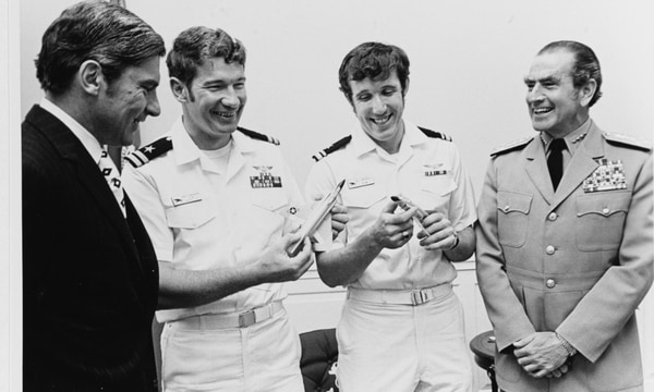 In 1972 at the Pentagon, then-Secretary of the Navy John W. Warner, left, met with Lt. Randall H. Cunningham, Lt. j.g. William P. Driscoll and Chief of Naval Operations Adm. Elmo Zumwalt. (Navy)
