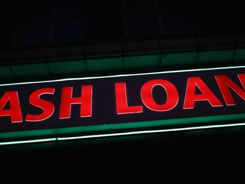 The Consumer Financial Protection Bureau is reporting considering changing its process for monitoring whether lenders are following the law regarding making high-interest loans to service members. (Dan Kitwood/Getty Images)