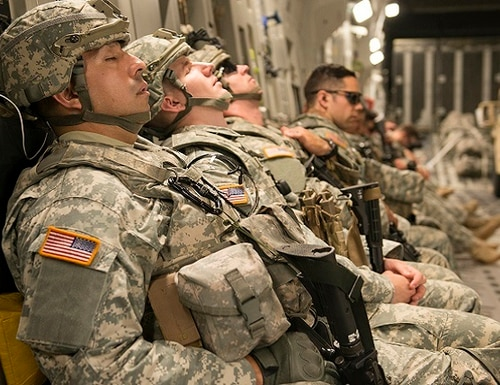 Army National Guard soldiers catch a few minutes of sleep onboard a C-17 Globemaster. Army-sponsored researchers are studying the effects of sleep deprivation. (Heide Couch/Air Force)