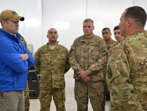 Ryan McCarthy, acting Army Secretary, speaks with soldiers from the 1st Attack Reconnaissance Battalion, 501st Aviation Regiment, 1st Armored Division Combat Aviation Brigade in Poland. (Sgt. Shiloh Capers/U.S. Army)