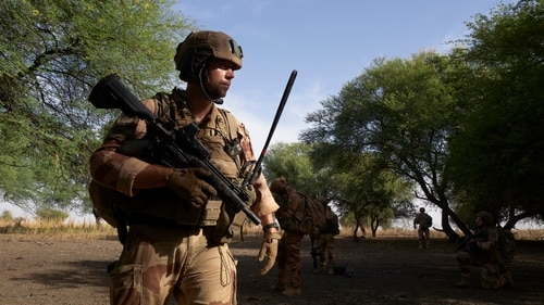 A group of soldiers of the French Army patrols the forest of Tofa Gala during the Bourgou IV operation in the Sahel region in northern Burkina Faso on November 9, 2019. It is the first time that the French Army, the national armies and the multinational force of the G5 Sahel (Mali, Burkina Faso, Niger, Mauritania and Chad) have officially worked together in the field. (Photo by Michele Cattani/AFP via Getty Images)
