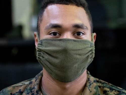 There's a simple way to repurpose your old skivvy shirt into a mask. (U.S. Marine Corps photo by Lance Cpl. David Esparza)