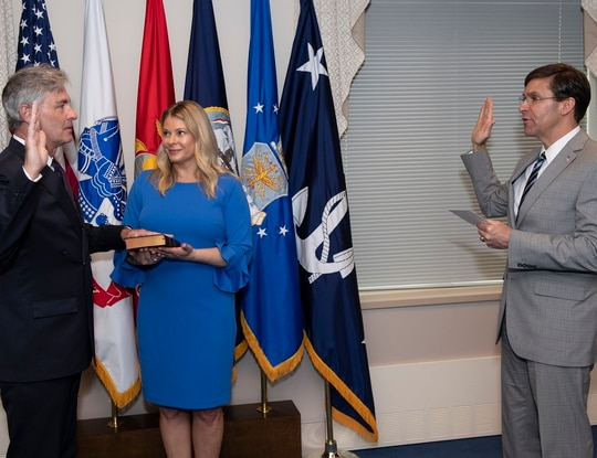 Kenneth J. Braithwaite, the 77th Secretary of the Navy, was sworn in Friday by Defense Secretary Mark Esper. His wife Melissa held the Bible. (Navy)
