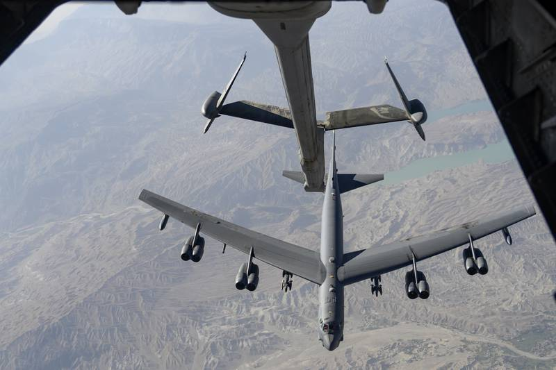 A U.S. Air Force B-52H Stratofortress aircraft approaches a KC-10 Extender aircraft over an undisclosed location in Southwest Asia to receive fuel during a mission on Aug. 13, 2021. (Tech. Sgt. Michelle Y. Alvarez/Air Force)