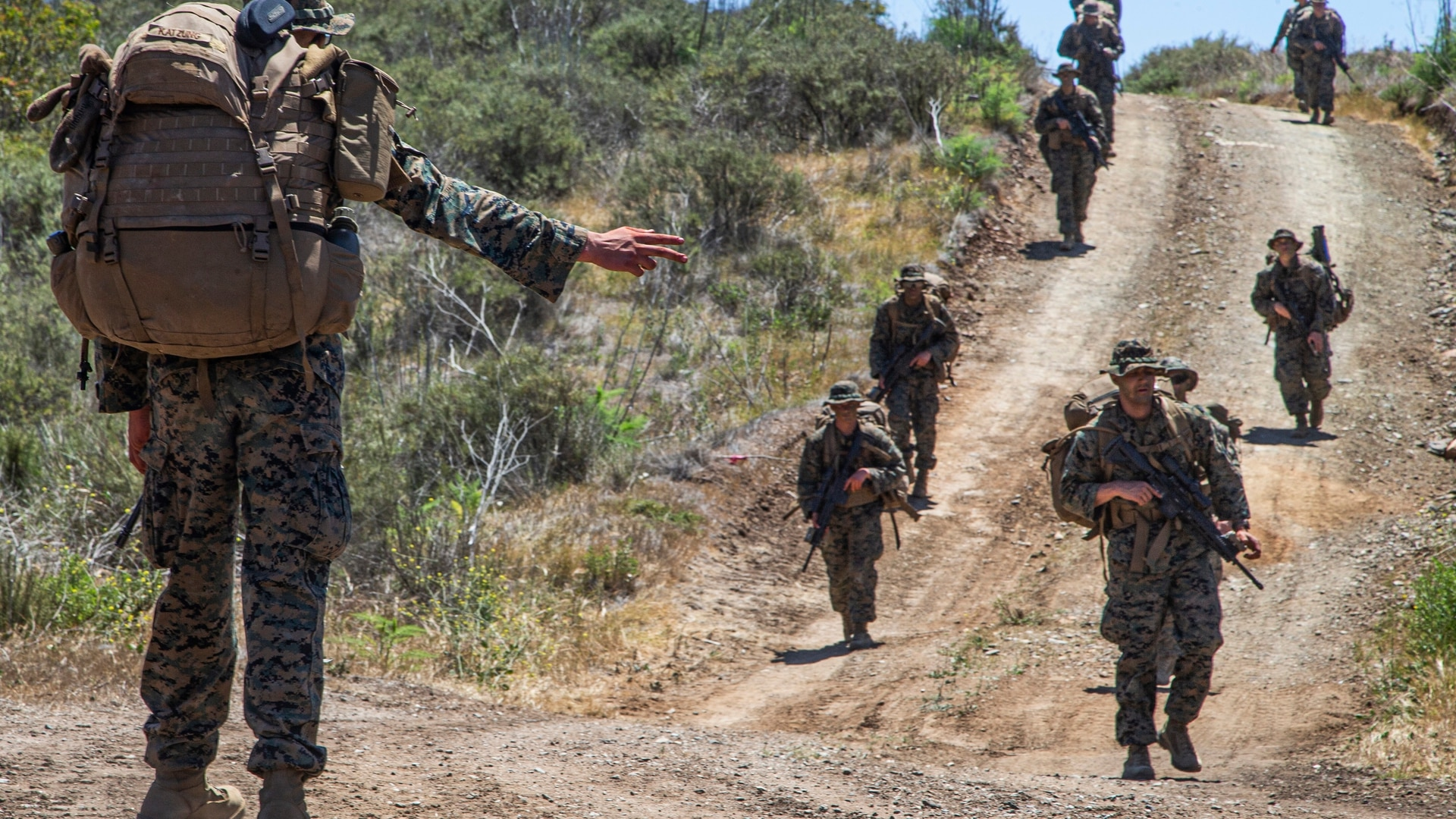 A squad from Alpha company tactically moves from station to station as part of the capstone exercise for the Infantry Marine Course on Marine Corps Base Camp Pendleton, California, April 29. (Sgt. Jeremy Laboy/Marine Corps)