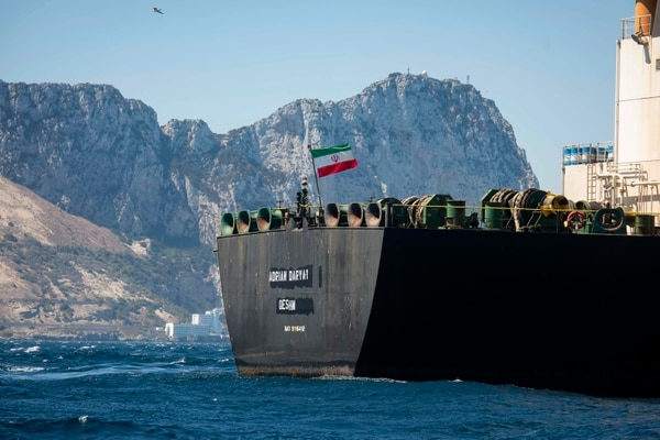 Renamed Adrian Aryra 1, the super tanker hosting an Iranian flag sails in the waters in the British territory of Gibraltar on Aug. 18. (Marcos Moreno/AP)