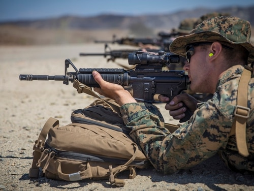 Marine Corps Lance Cpl. Elliot Holter zeroes his rifle combat optic on his M4A1 service rifle during a live-fire range at Marine Corps Base Camp Pendleton, California. (Lance Cpl. Dalton S. Swanbeck/Marine Corps)