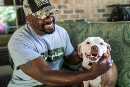 Omar Brooks pets Maisie Mae, a foster dog at Bridge To Home Animal Rescue on July 6, 2020, in Eighty Four, Pa. (Andrew Rush/Pittsburgh Post-Gazette via AP)