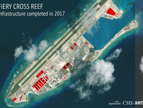This image provided by CSIS Asia Maritime Transparency Initiative/DigitalGlobe shows a satellite image of Fiery Cross Reef in Spratly island chain in the South China Sea, annotated by the source to show areas where China has conducted construction work above ground during 2017. (CSIS Asia Maritime Transparency Initiative/DigitalGlobe via AP)