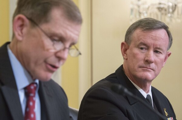 Assistant Secretary of Defense for Special Operations/Low-Intensity Conflict Michael D. Lumpkin, left, and Adm. William McRaven, then commander of Special Operations Command, testify March 11, 2014, at a Senate Armed Services subcommittee hearing in Washington. (Jim Watson/AFP via Getty Images)