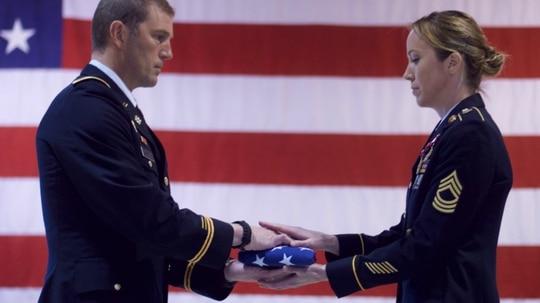 Alaska Army National Guard Master Sgt. Elaine Jackson marks 20 years of service during her May 20, 2018, retirement ceremony at the Alaska National Guard Armory, Joint Base Elmendorf-Richardson, Alaska. (Sgt. David Bedard/Army National Guard)