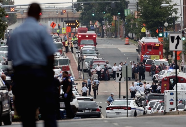 WASHINGTON, DC - SEPTEMBER 16: Emergency vehicles and law enforcement personnel respond to a reported shooting at the Washington Navy Yard September 16, 2013 in Washington, DC. According to news reports several people were shot with a shooter still active. (Photo by Alex Wong/Getty Images)