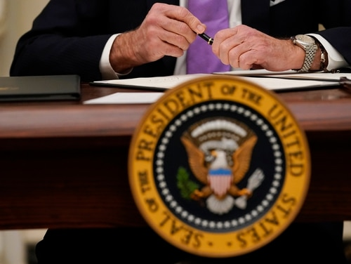 President Joe Biden signed an executive order Jan. 22 to overturn previous Trump administration union restrictions and to guarantee a higher minimum wage. (Alex Brandon/AP)