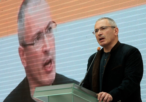 FILE - In this Thursday, April 24, 2014 file photo, Russian former oil tycoon Mikhail Khodorkovsky speaks at the Ukraine-Russia Dialogue conference in Kiev, Ukraine. The exiled Russian oligarch was once one of the country's richest men and was imprisoned in 2003 on charges of fraud and tax evasion. He was released in 2013, and now lives in Switzerland, from where he promotes democratic reform in Russia. He was the target of 13 phishing emails during April-December 2015, according to data from the cybersecurity firm Secureworks. (AP Photo/Sergei Chuzavkov)