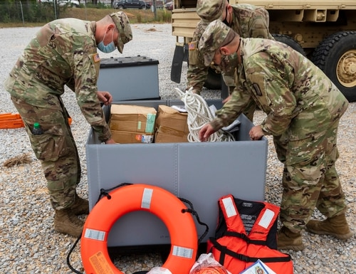 Mississippi Army National Guard Soldiers assigned to an engineer composite team pack supplies in preparation to conduct high-water rescues in response to Hurricane Sally at Camp Shelby Joint Force Training Center, Miss., Sept. 15, 2020. (U.S. Army National Guard photo by Cdt. Jarvis Mace)