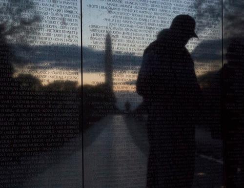 Veterans visit the Vietnam Veterans Memorial in Washington on Veterans Day in 2014. (Mike Morones/Gannett Government Media)