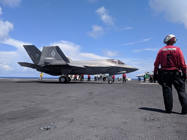 An F-35C maneuvers after landing on the flight deck of the carrier Abraham Lincoln, operating off the coast of Virginia. (David B. Larter/Staff)