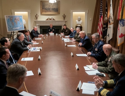 President Donald Trump, meets with Cabinet secretaries, senior military leadership and national security team members on May 8, 2020. No one wore masks despite sitting within 6 feet of each other. (White House/Flickr)