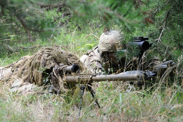 The current ghillie suit, known as the Flame Resistant Ghillie System, is shown here. A new suit, called the Improved Ghillie System, or IGS, is under development. (Army)