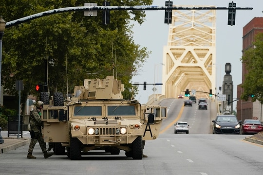 Military vehicles enter the city ahead of a 9 p.m. curfew, Wednesday, Sept. 23, 2020, in Louisville, Ky. (Darron Cummings/AP)
