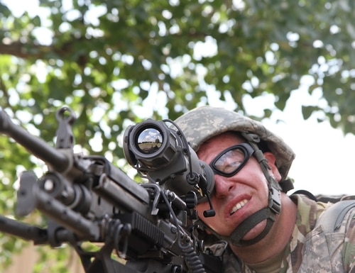 Army Reserve Sgt. Matthew Moore puts an eye on a target. The Army secretary is reviewing recruiting standards for issues like eyesight. (Staff Sgt. Christopher J. Sofia/Army)