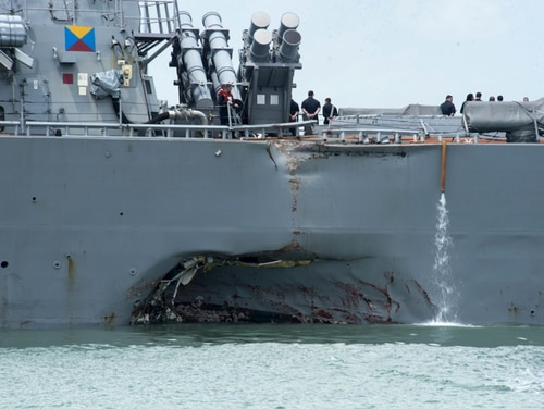 Damage to the portside is visible as the Guided-missile destroyer USS John S. McCain (DDG 56) steers towards Changi naval base in Singapore following a collision with the merchant vessel Alnic MC Monday, Aug. 21, 2017. The USS John S. McCain was docked at Singapore's naval base with significant damage to its hull after an early morning collision with the Alnic MC as vessels from several nations searched Monday for missing U.S. sailors. (Mass Communication Specialist 2nd Class Joshua Fulton/U.S. Navy photo via AP)