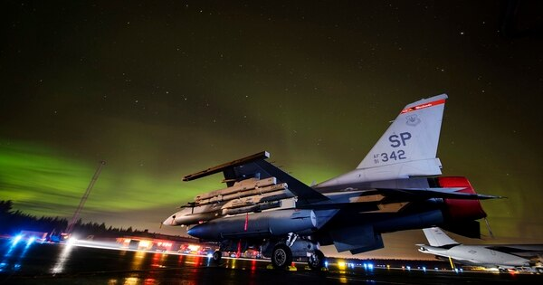 An F-16 Fighting Falcon assigned to the 480th Expeditionary Fighter Squadron sits on the flight line under the aurora borealis during exercise Trident Juncture 18 at Kallax Air Base, Sweden, Nov. 5. Staff Sgt. Jonathan Snyder/Air Force)