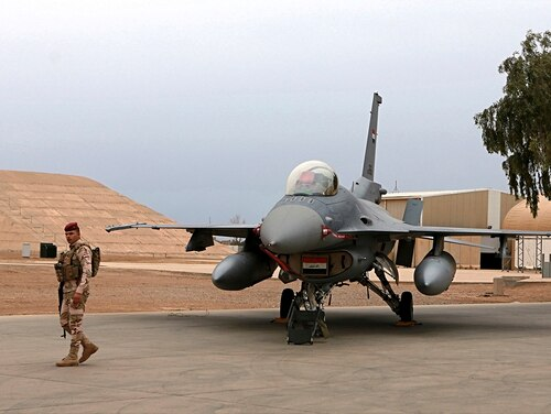 In this Feb. 13, 2018, file photo, an Iraqi army soldier stand guard near a U.S.- made Iraqi Air Force F-16 fighter jet at the Balad Air Base, Iraq. (Khalid Mohammed/AP)