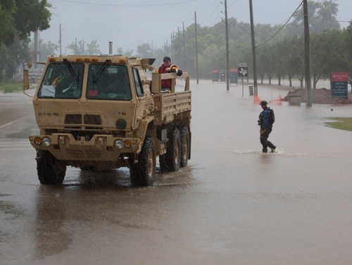 Texas National Guard Light Medium Tactical Vehicle (LMTV) takes responders to various locations to rescue citizens on June 2, 2016. A similar vehicle, driven by 1st Cavalry Division soldiers at Fort Hood, Texas, was swept away on post that day. (Staff Sgt. Timothy Pruitt/Texas State Guard)