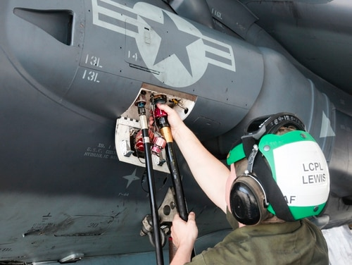 Lance Cpl. Daniel Lewis, a fixed-wing aircraft airframe mechanic with Marine Attack Squadron 231, Marine Aircraft Group 14, 2nd Marine Aircraft Wing connects a hydraulic hose to an AV-8B Harrier aboard Marine Corps Air Station Cherry Point, N.C., June 30, 2016. By performing daily tasks and needed maintenance on the aircraft to ensure readiness, Marines maintain their squadron's ability to deploy at a moment's notice. (United States Marine Corps photo by Sgt. Austin Long/ Released)