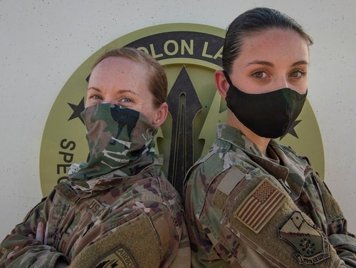Air Force Capt. Monica Clements, and Air Force Staff Sgt. Heather Fejerang pose for a photo, June 30, 2020, at Al Udeid Air Base, Qatar. Clements arrived at Al Udeid in October 2019, and is completing a nine-month deployment as her sister starts hers. (Tech. Sgt. Michael Battles/Air Force)