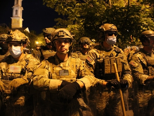 Protests on Wednesday night remained peaceful, as troops from various state National Guard units took up positions near the White House on June 3, 2020. (Kyle Rempfer/Staff)