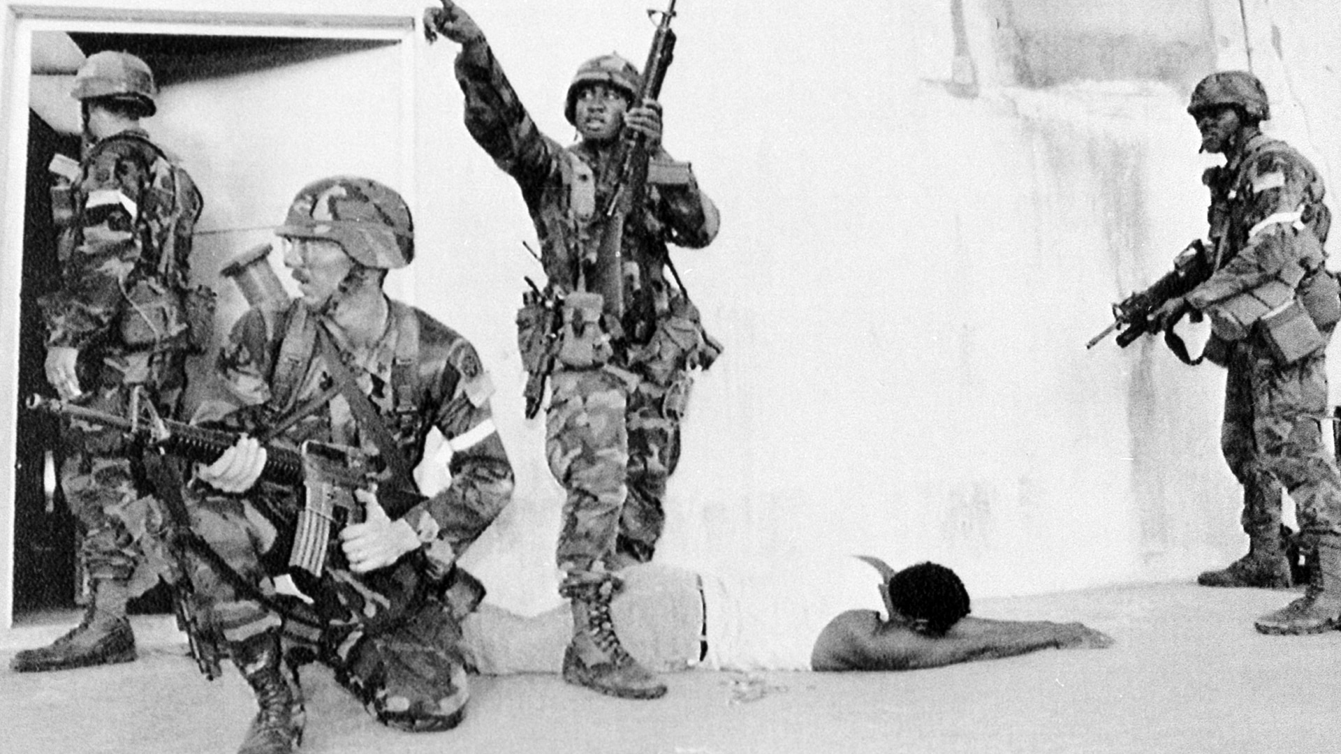 A Panamanian man is detained by troops from the 82nd Airborne Division during a sweep of the Viejo section of Panama City on Dec. 27, 1989. (DoD via the AP)