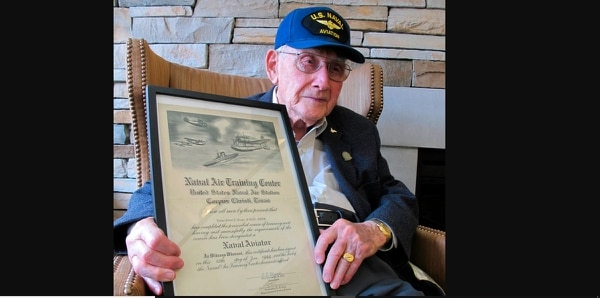In this April 25 photo, World War II veteran Bob Barger poses with his naval flight school certificate in Toledo, Ohio. (John Seewer/AP)