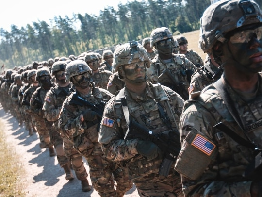 Soldiers with 1st Squadron, 2nd Cavalry Regiment march in a multinational formation at Wierzbiny, Poland, June 4, 2018. (Spc. Hubert D. Delany III/Army)