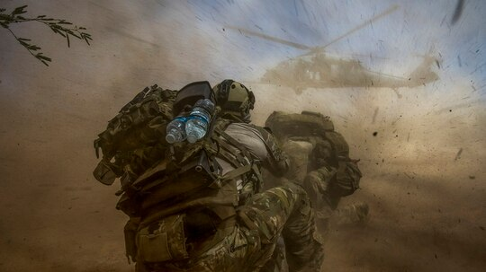 Pararescuemen with the 58th Rescue Squadron out of Davis-Monthan Air Force Base, Arizona, prepare for aerial transport during a personnel recovery scenario. (Staff Sgt. Marianique Santos/Air Force)