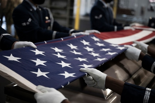 Ceremonial Guardsmen of the Base Honor Guard fold the American flag during a practice exercise at Little Rock Air Force Base, Ark., Aug. 25, 2020. (Airman 1st Class Isaiah Miller/Air Force)
