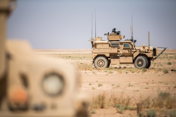 U.S. Marines with Weapons Company, 3rd Battalion, 7th Marine Regiment provide security support during mission on Sept. 9, 2018, at an undisclosed location in Syria. (Cpl. Gabino Perez/Marine Corps)