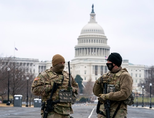 Members of the National Guard patrol the area outside of the U.S. Capitol on the third day of the second impeachment trial of former President Donald Trump, on Feb. 11, 2021. (Jose Luis Magana/AP)