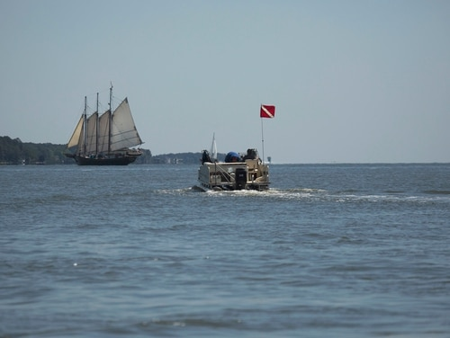 A crew working on a project to reassess shipwrecks from the Revolutionary War in Yorktown, Va., makes their way across the York River on May 15. (L. Todd Spencer/The Virginian-Pilot via AP)