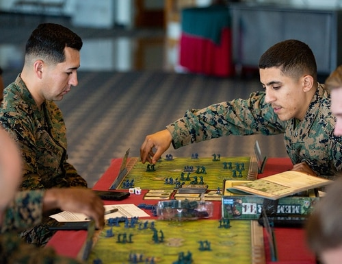 Marines with 3rd Marine Division play a game of Memoir 44' on Camp Schwab, Okinawa, Japan. But something a little more advanced is in store as the Corps expects to break ground on a wargaming center at Marine Corps Base Quantico, Virginia, in 2021 (Cpl. Timothy Hernandez/Marine Corps)