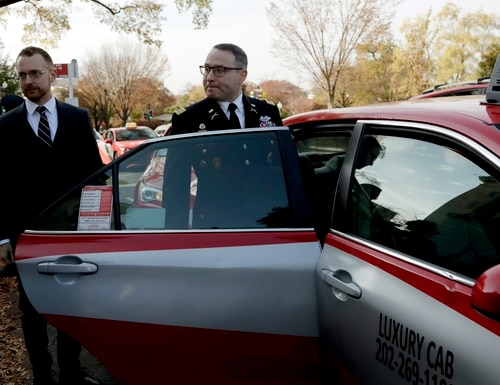 Then- National Security Council aide Lt. Col. Alexander Vindman leaves Capitol Hill on Nov. 19, 2019, after testifying before the House Intelligence Committee during a public impeachment hearing regarding President Donald Trump's call to the Ukrainian president. (Julio Cortez/AP)