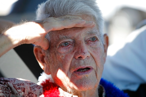Pearl Harbor survivor Ray Emory speaks to guest at a surprise ceremony honoring him, Tuesday, June 19, 2018, in Honolulu. Emory, who served aboard the USS Honolulu during the 1941 attack, is moving back the the mainland and wanted to visit the site where his former ship was moored one last time. (Marco Garcia/AP)