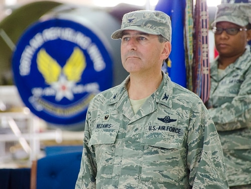 Col. Peter Nezamis, commander of the 126th Air Refueling Wing, accepts the Air Force Oustanding Unit Award on behalf of the 126 ARW at Scott Air Force Base, Ill., on Oct. 4, 2014. (Master Sgt. Ken Stephens/Air National Guard)