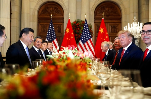 In this Dec. 1 photo, U.S. President Donald Trump and China's President Xi Jinping, second left, attend their bilateral meeting at the G20 Summit in Buenos Aires, Argentina. A U.S.-Chinese cease-fire on tariffs gives jittery companies a respite but does little to resolve a war over Beijing's technology ambitions that threaten to chill global economic growth. (Pablo Martinez Monsivais/AP)