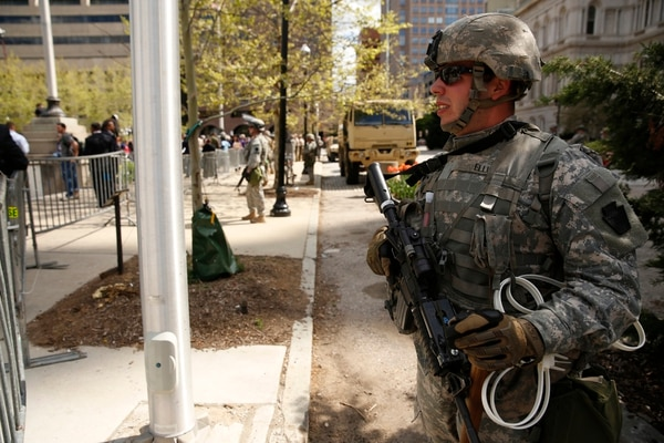 Pvt. Matthew Ellis of A Company, 1-175th Infantry, Maryland National Guard, stands post in front of City Hall in Baltimore, Md., on Tuesday, April 28, 2015. Maryland governor Larry Hogan activated the Guard after rioting in the wake of the funeral of Freddie Gray who died in police custody. (Mike Morones/Army Times)