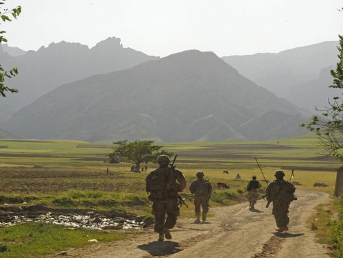 An Afghan Border Police officer leads U.S. soldiers down a dirt road in Badakhshan province, Afghanistan. DoD has officially released a new policy that all service members are to be world-wide deployable and those who have not deployed in the last 12 months may be targeted for separation. (DoD)